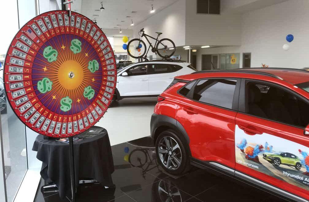 US Big Wheel at a car yard